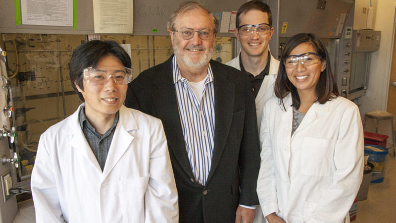 Ken Raymond with research group members in 2013.