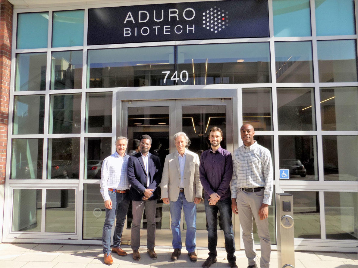 College of Chemistry and Aduro Biotech staff stand in front of the company entrance