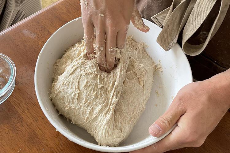 Demonstrating making sourdough bread