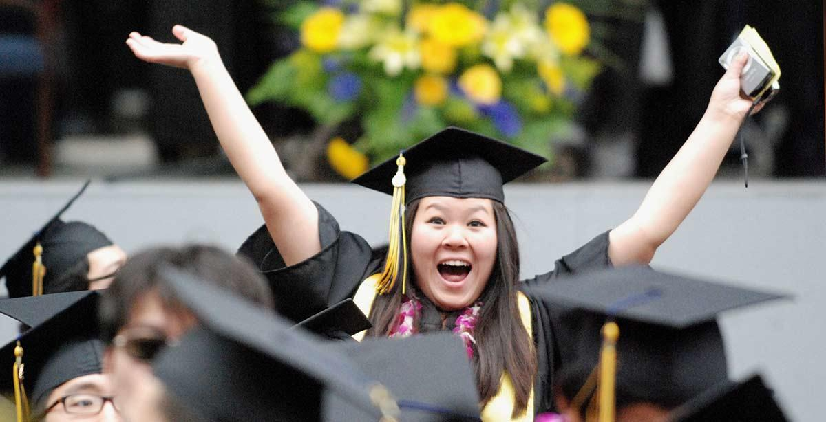 Graduating student celebrating at commencement