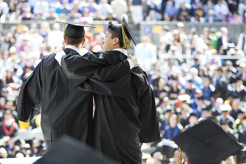 Graduating students celebrating at commencement