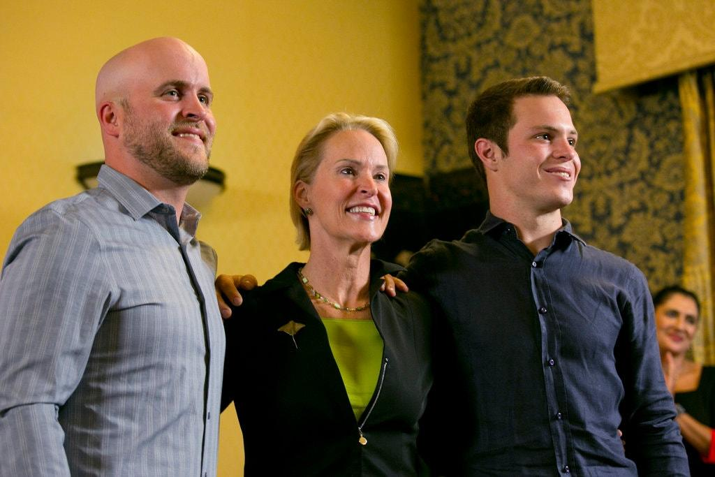 Dr. Arnold with her sons James Bailey, left, and Joseph Lange at Caltech last fall. Credit Damian Dovarganes/Associated Press