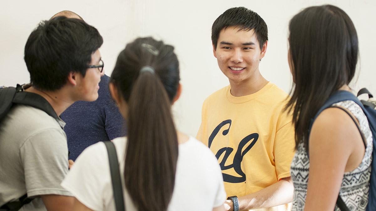 A group of students talking and laughing