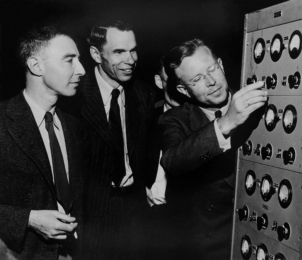 Ernest O. Lawrence, Glenn T. Seaborg, and J. Robert Oppenheimer in early 1946 at the controls to the magnet of the 184-inch cyclotron