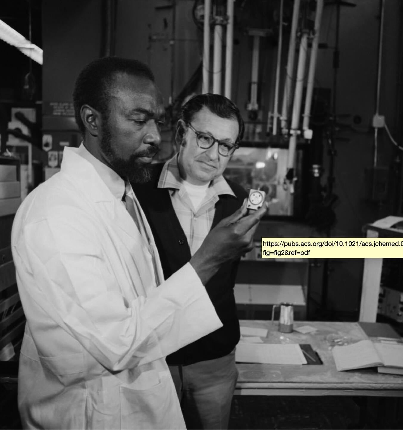 James Harris (left) and Albert Ghiorso with the target used to create isotopes of elements 104 and 105 in Berkeley Lab's Heavy Ion Linear Accelerator. April 21, 1970.