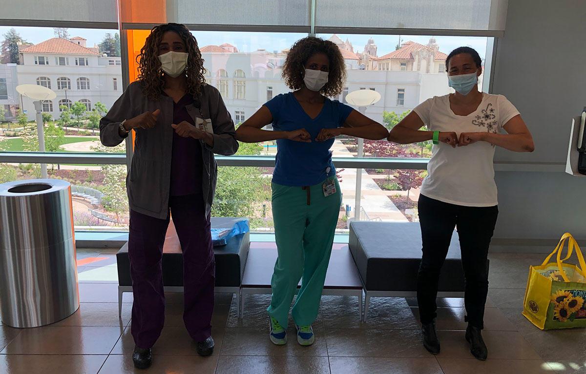 Nursing staff from Highland Hospital greet staff