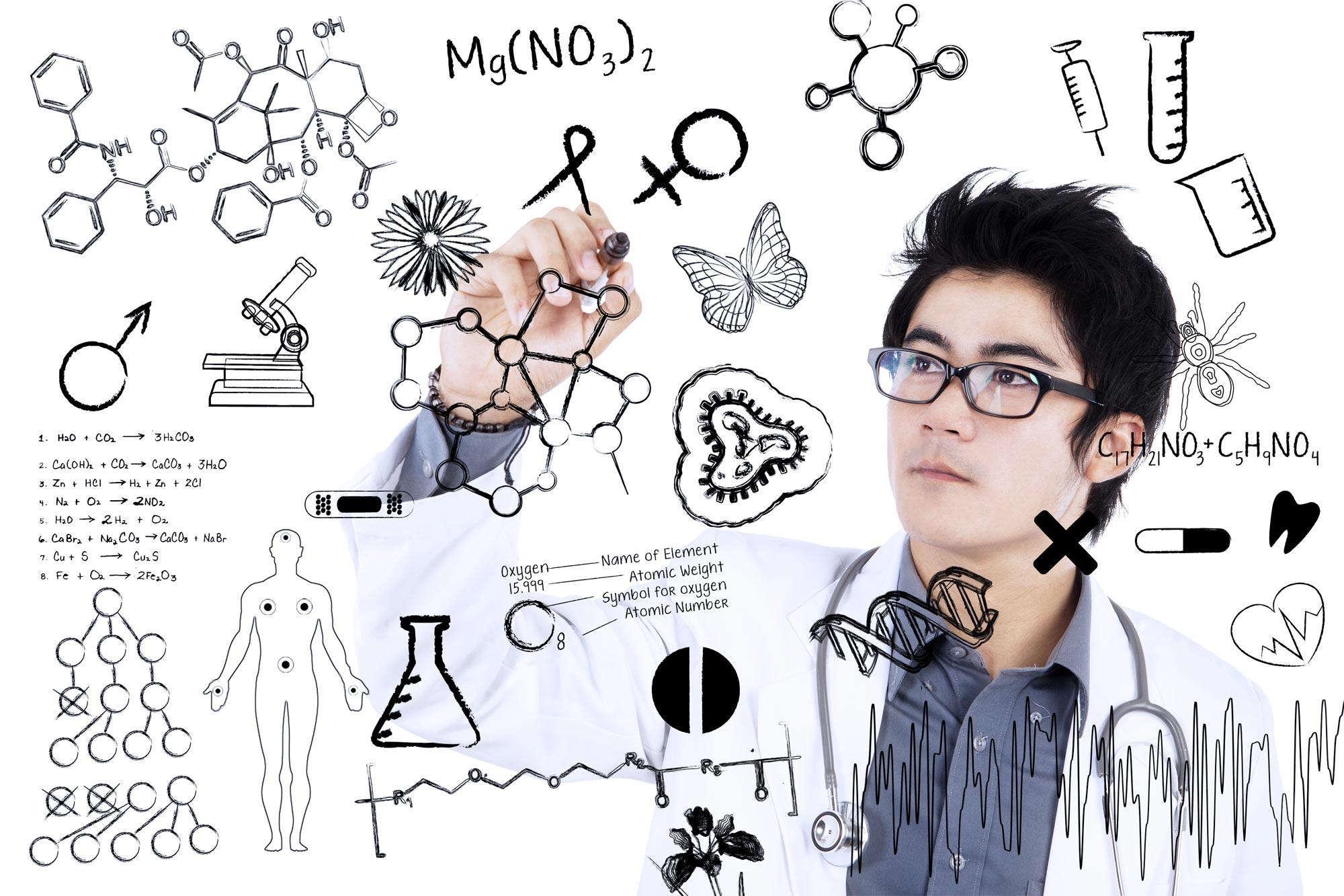 Scientist at whiteboard.
