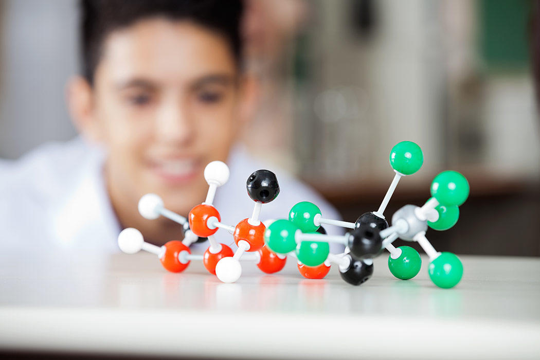 Student with model of molecule
