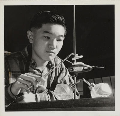 Student Harry Ishigaki performs chemistry experiment at Heart Mountain