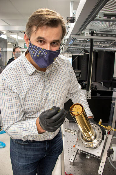 Michael Zuerch assembles a cryogenic sample holder.